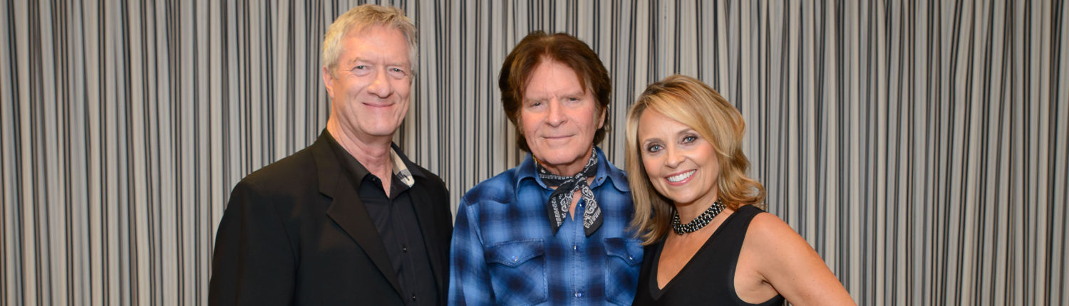 Harley and Maryanne Sefton with John Fogerty at the 2016 Wine D'Vine fundraiser