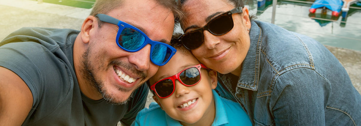Selfie of an adoptive family wearing sunglasses