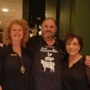 """Jeffrey Strauss(c) poses with Kathryn Stephens (l) and Walden Governance board chair Arlene Lieberman (r) wearing his """"Real Housewives"""" apron"""
