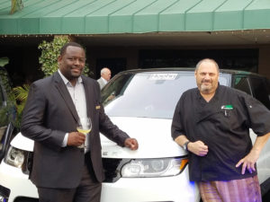 Rajah Gainey and Pamplemousse Grille Executive Chef Jeffrey Strauss check out the Land Rover