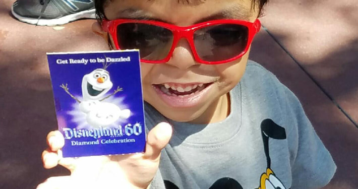 David excited to hold his Disney ticket