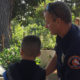 Picture of foster youth with firefighter from Los Angeles County Station #7
