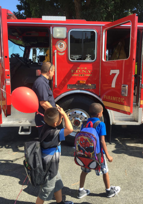 Foster youth checking out fire truck from West Hollywood Station #7
