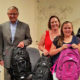 Community leaders posing with youth who donated backpacks