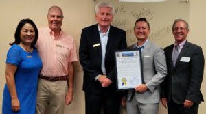 City Councilmembers present Walden with proclamation