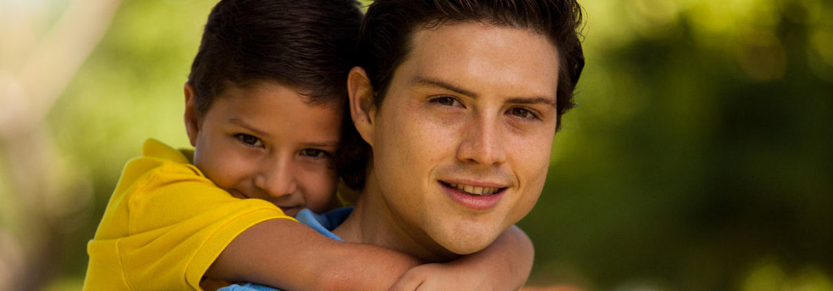 Picture of young Hispanic father with son
